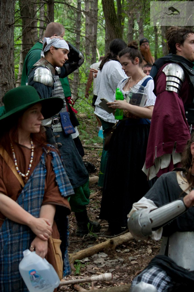During the woods battle at Pennsic I ended up with a nasty concussion early in the battle. My expression shows how 'happy' I am to be out of the fight. Not. Was cleared by EMTs but I was determined to help. Was able to bring water to the fighters for the rest of the day.